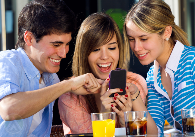excited-group-young-friends-using-smartphone