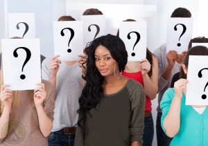 female-surrounded-by-people-with-question-marks