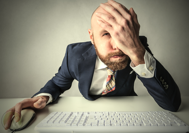 frustrated-bald-male-businessman-facepalm-using-computer