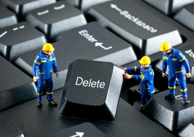 miniature-human-figures-fixing-keyboard-delete-button
