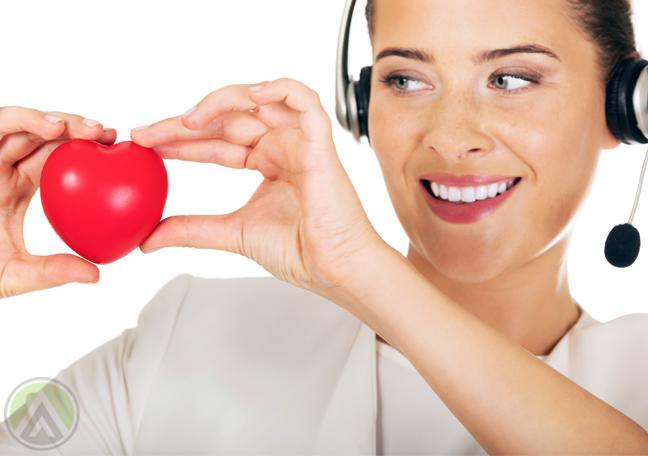 smiling-female-call-center-agent-holding-heart