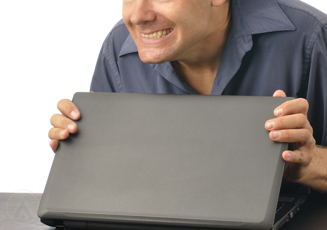 sneaky-businessman-covering-laptop