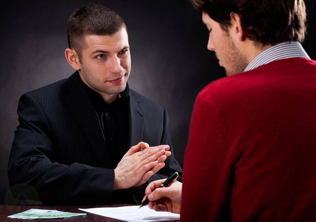 sneaky-businessman-watching-victim-sign-contract