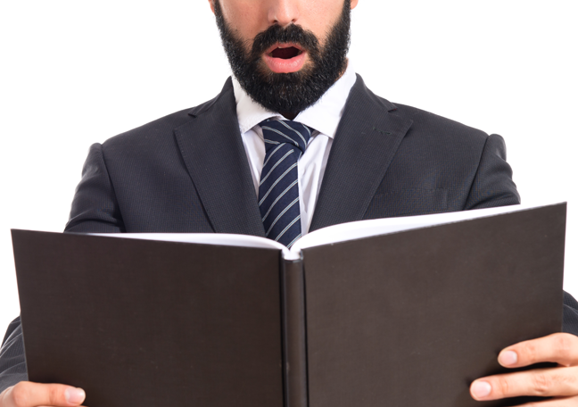 bearded-businessman-reading-book