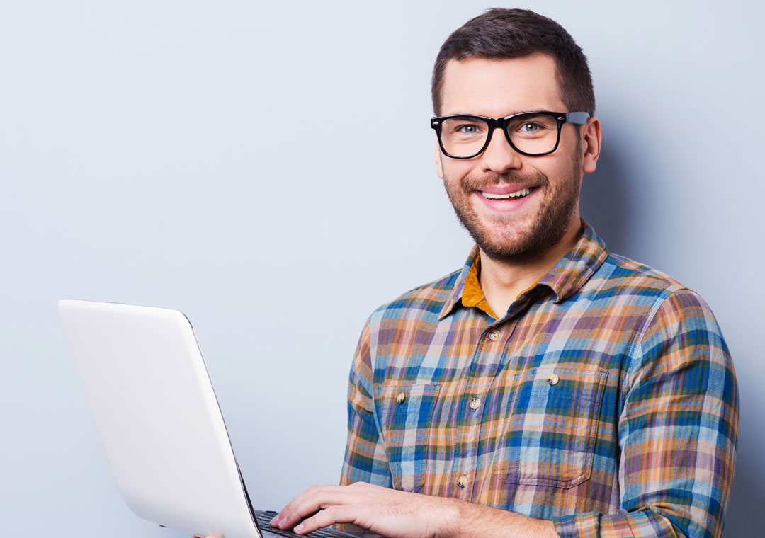 bilingual call centers agent smiling using laptop