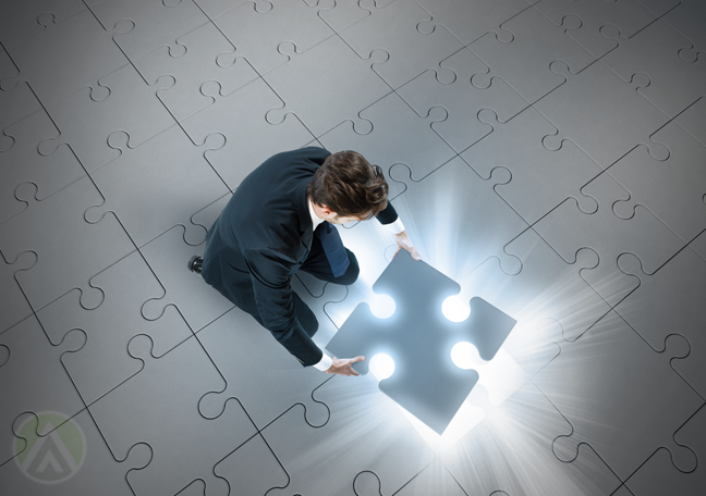 businessman-pickung-up-glowing-jigsaw-puzzle-piece-from-floor