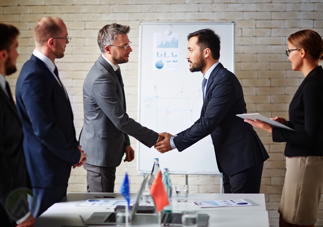 caucasian-businessman-shaking-hand-with-asian-business-partner