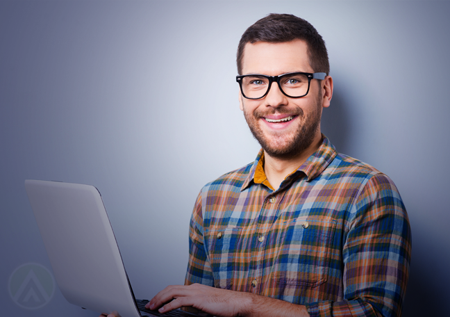 delighted-man-in-glasses-using-laptop