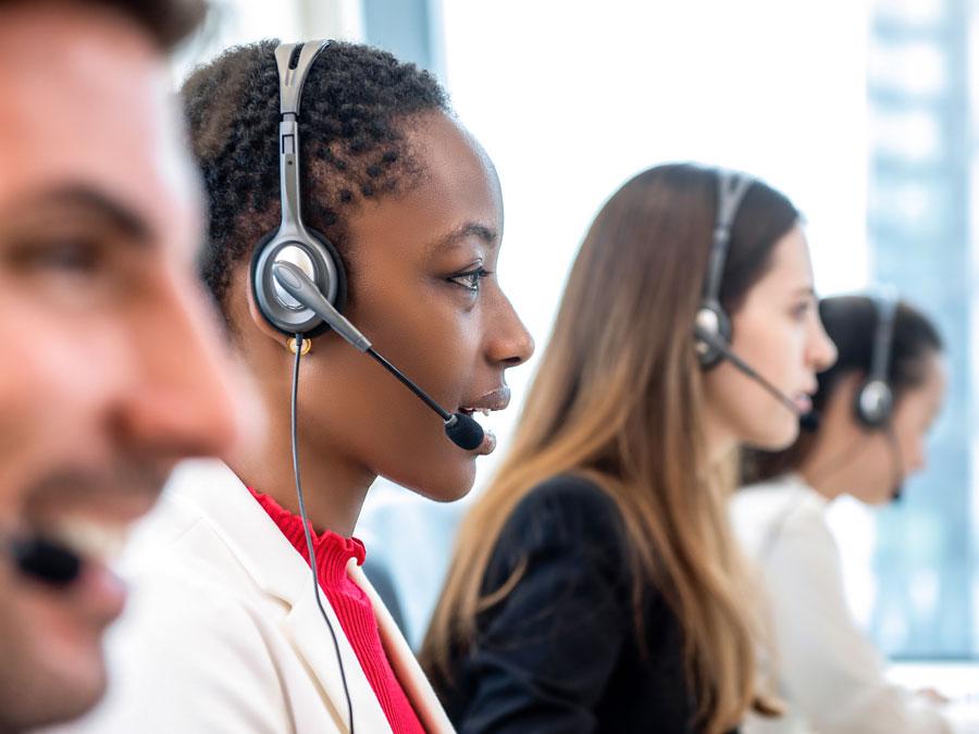 diverse bilingual call center agents hard at work