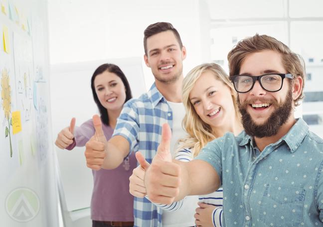 millennial-business-team-giving-thumbs-up