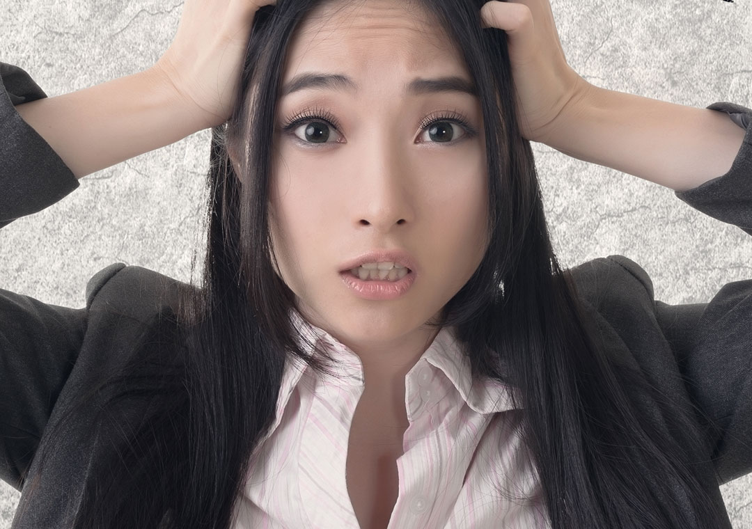 worried confused asian agent from bilingual call centers