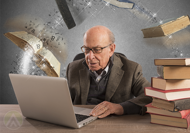 matured-man-with-piles-of-books-using-laptop