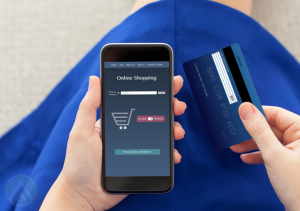 woman-in-blue-dress-using-smartphone-with-credit-card