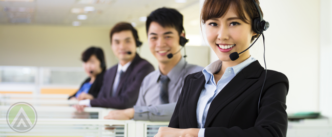Asian-Filipino-customer-service-agents-standing-by-their-call-center-office-cubicles