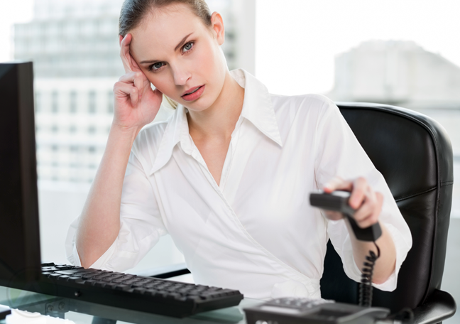 annoyed-female-business-executive-hanging-up-phone