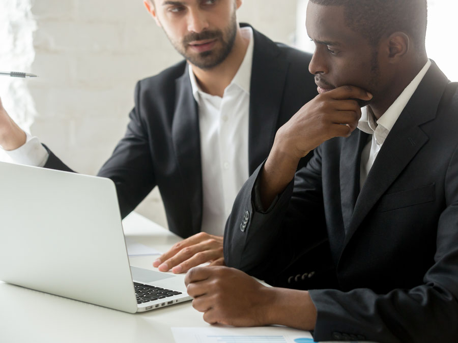 business executives doing online business research discuss