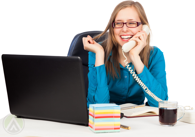 delighted-female-worker-speaking-on-phone-looking-at-laptop