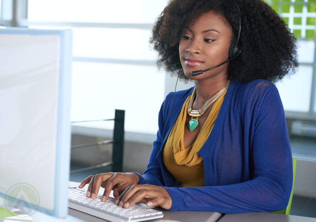ethnic-female-customer-service-agent-typing-on-computer