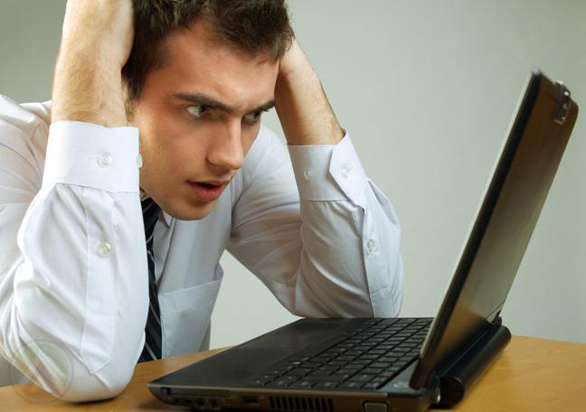 male-employee-panic-laptop