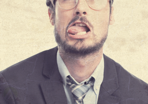 bearded-businessman-in-glasses-tongue-out-making-faces
