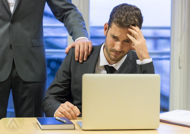 boss-comforting-hand-on-sad-employee