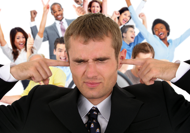 businessman-covering-ears-with-noisy-coworkers