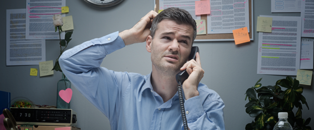 businessman-in-busy-office-scratching-head