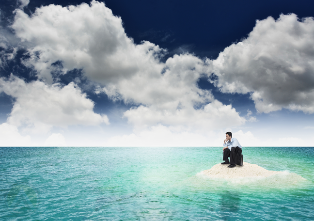 businessman-stuck-alone-in-small-island-by-the-sea
