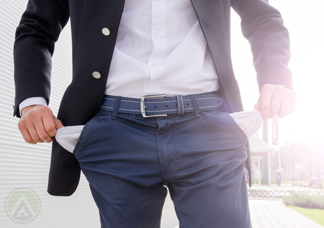 businessman-torso-pulling-out-empty-pockets