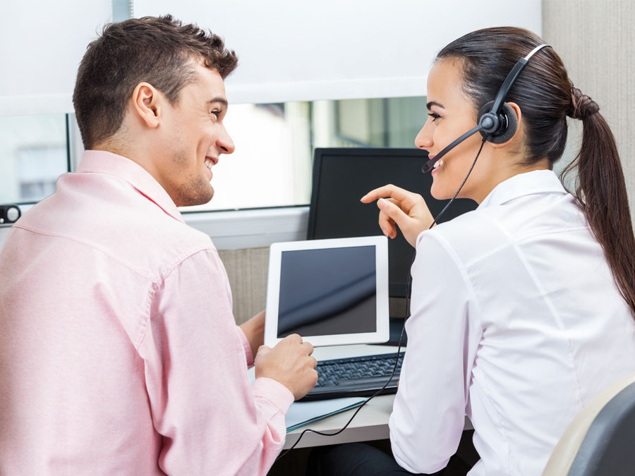 call center agents using tablet laptop computer for customer service