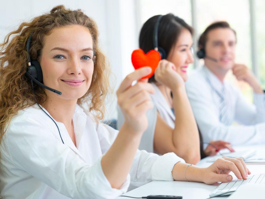 call center team holding red heart