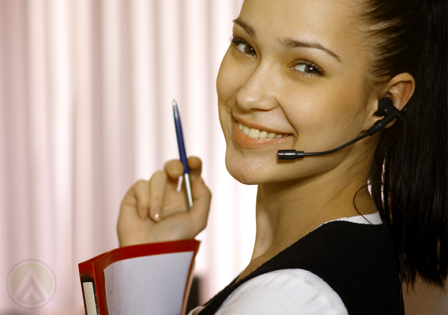 close-up-shot-of-smiling-female-customer-service-agent-holding-pen