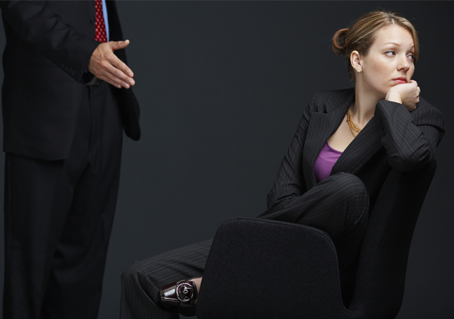 distracted-businesswomen-looking-away-from-businessman-offering-to-shake-hands