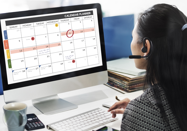 femalecall-center-agent-viewing-calendar-on-computer