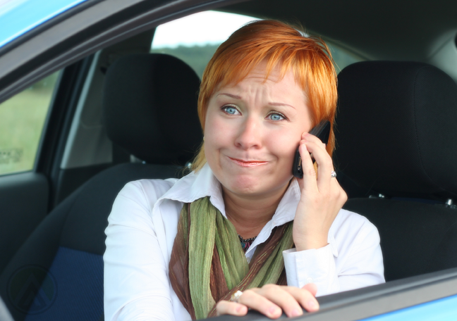 frustrated-woman-in-car-making-phone-call