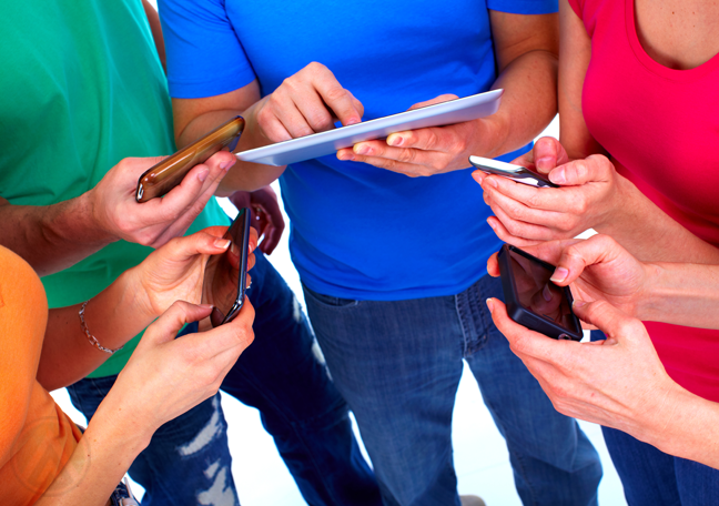 people-in-colorful-shirts-using-tablet-smartphones