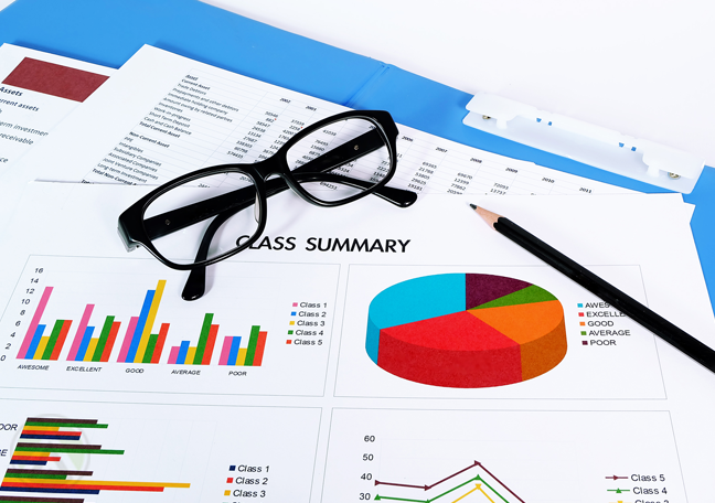 printed-business-graphs-and-charts-with-eye-glasses-pencil