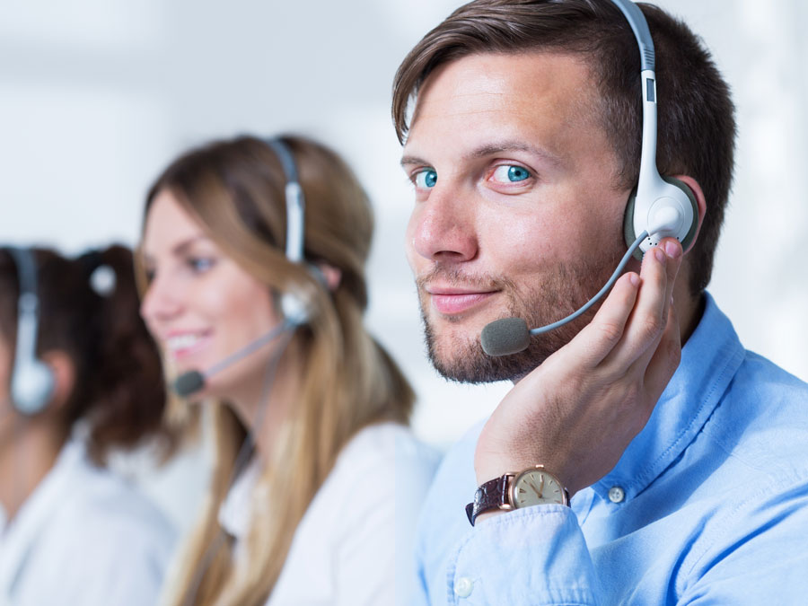 smiling call center agent working with customer support team