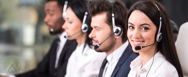 smiling-female-customer-service-agent-with-call-center-coworkers