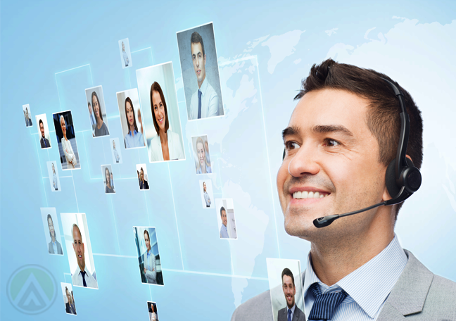 smiling-male-call-center-agent-looking-at-photos-in-virtual-interface