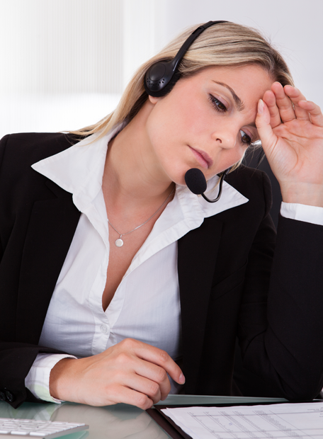 tired-frustrated-female-call-center-agent-reading-document