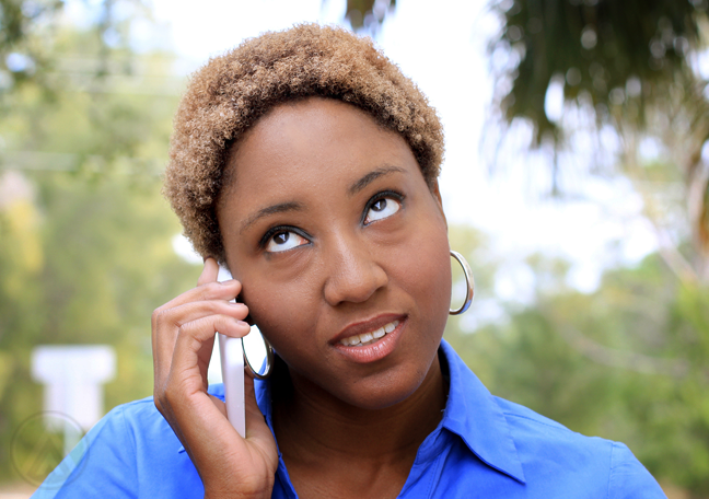 woman-rolling-eyes-outdoors-on-the-phone-call