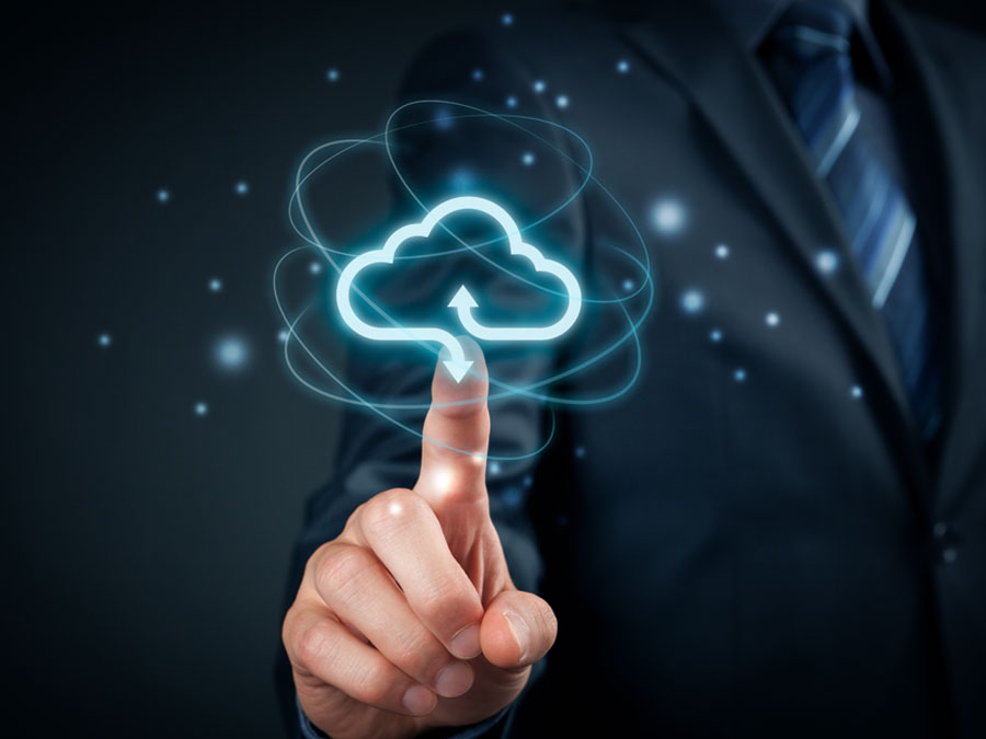 business executive IT manager pointing to cloud storage icon