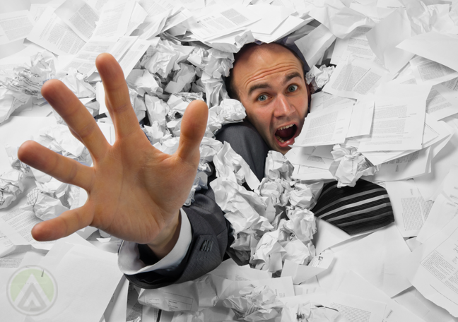 businessman-drowning-in-paper-work