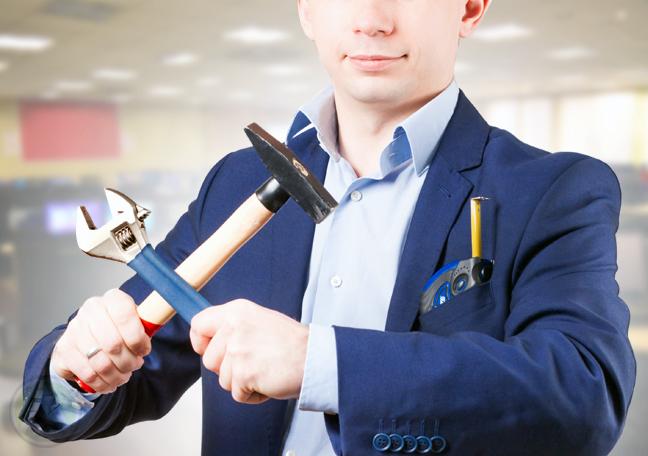 businessman-holding-tools