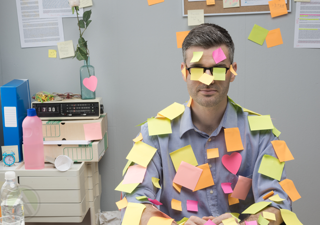 businessman-in-office-covered-in-posti-it-notes