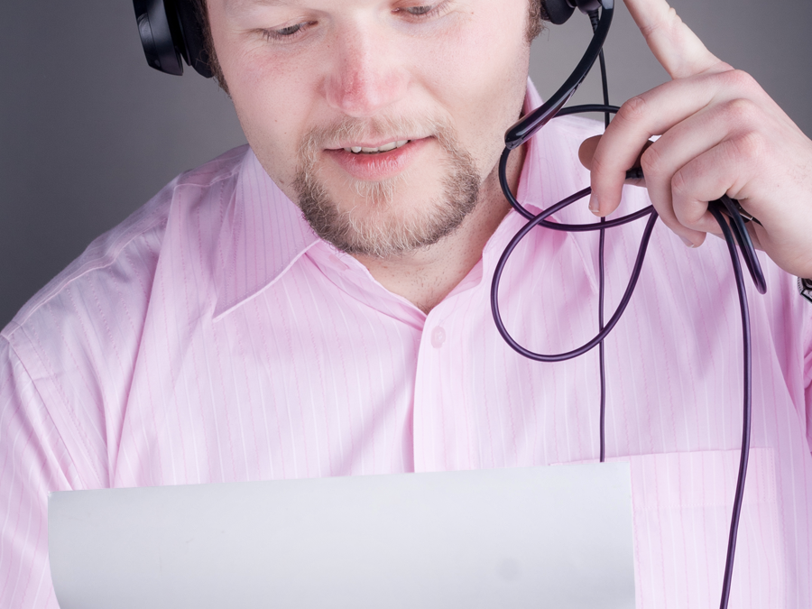 call center agent in pink reading sheet of paper