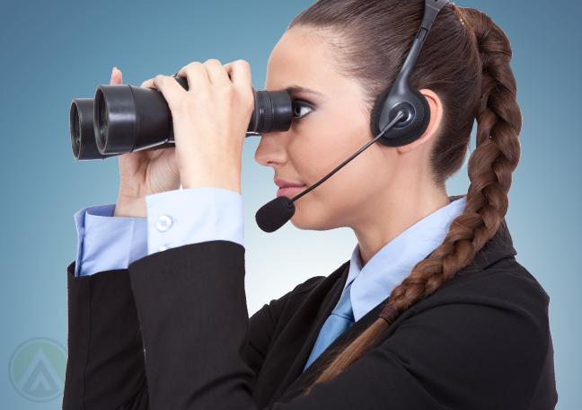 call-center-agent-looking-through-binoculars
