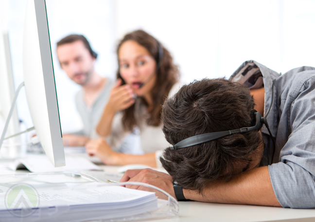 customer-service-agent-sleeping-at-work-with-shocked-call-center-coworkers