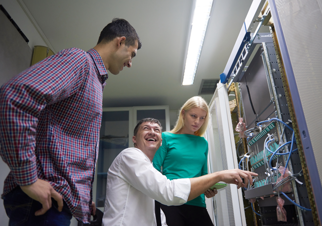 it-experts-talking-laughing-in-data-center-server-room
